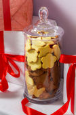 Gingerbread Cookies in a jar and Christmas gifts — Stock Photo