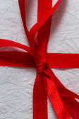 Red ribbon on a Christmas gift — Stock Photo
