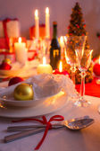 Cutlery with red ribbon on the holiday table — Stock Photo