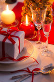 Red ribbon as an accent on Christmas table — Stock Photo