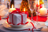 Surprise waiting for the familly on a Christmas table — Stock Photo