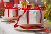 Special Christmas gifts for everyone on plates — Stock Photo