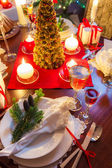 Preparation for dinner at Christmas table — Stock Photo