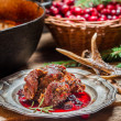 Stock Photo: Venison with cranberry sauce and rosemary