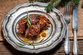 Plate with baked venison with rosemary — Stock Photo
