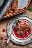 View of venison with cranberry sauce and rosemary — Stock Photo