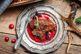 Fresh Venison with cranberry sauce and rosemary — Stock Photo