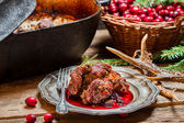 Venison with cranberry sauce and rosemary straight from the fore — Stock Photo