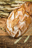 Large loaf of bread in a rural bakery — Stock Photo