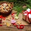 Christmas gingerbread and a small gift — Stock Photo