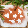 Shapes of gingerbread cookies on a sheet of paper and cocoa — Stockfoto