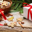 Gingerbread cookies in powdered sugar with cinnamon bark — Stock Photo #32093251