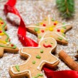 Closeup on the Gingerbread Man on a red ribbon — Stock Photo
