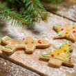 Small gingerbread cookies on wooden table with spruce — Stockfoto