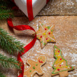 Gingerbread cookies for Christmas on the table with powdered sug — Stockfoto