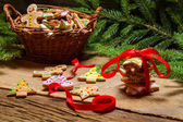 Red ribbon and gingerbread cookies for Christmas — Stock Photo