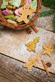 Gingerbread cookies and wicker basket for Christmas — Stock Photo
