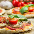 Freshly baked mini pizzas — Stock Photo #32432879
