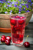Fresh juice of sweet cherries with ice — Stock Photo