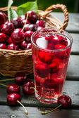 Fresh juice made of sweet cherries and ice — Stock Photo