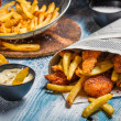 Closeup of Fish & Chips served in paper — Stock Photo