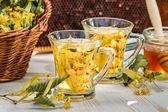 Tea with lime and honey — Stock Photo