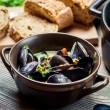 Fresh ingredients for a dish cooked with mussels — Stock Photo #32663823