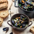 Fresh ingredients for a dish cooked with mussels — Stock Photo #32664085