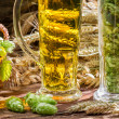 Closeup of hop cones collected in a pint of beer — Stock Photo