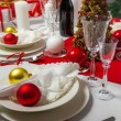 Wafer and gift on Christmas table — Stock Photo