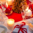 Candlelight on a table decorated beautifully for Christmas — Stok fotoğraf