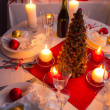 Many gifts near Christmas tree in candlelight — Foto Stock #32669883