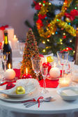 Preparing for Christmas Eve at beautifully decorated table — Stock Photo