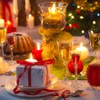 图库照片: Christmas drinks and presents for long winter nights