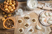 Table full of ingredients for homemade dumplings — Stock Photo
