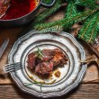 Stock Photo: Metal plate with baked venison