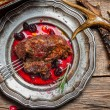 Stock Photo: Venison served with cranberry sauce