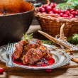 Stock Photo: Venison with cranberry sauce in forester