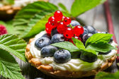 Small cupcake with fruits in forest — Stock Photo