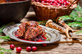 Roast venison with cranberry sauce with rosemary — Stock Photo
