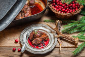 Freshly roasted venison with cranberry sauce and rosemary — Stock Photo