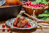 Venison with cranberry sauce in the forester — Stock Photo