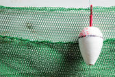 Green fishing net with floats — Stock Photo
