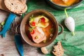 Fish soup spiced with dill and chilli pepper — Stock Photo