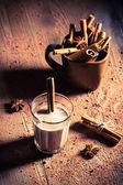 Milk with cocoa and cinnamon — Stock Photo