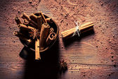 Closeup of cinnamon bark in brown cup — Stock Photo