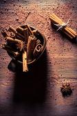 Cinnamon bark in brown cup — Stock Photo