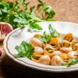 Snails baked in garlic butter served on a plate — Stock Photo
