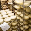 Stock Photo: Ripened cheeses lying in cold storage