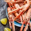 Freshly cooked scampi in a blue bowl — Stock Photo #35626755